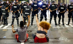 Police clash with protesters in Charlotte, North Carolina, during another night of unrest.
