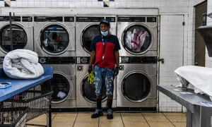 Gregory Stark, 54, an employee at a laundromat poses for a picture in Miami on 17 April 2020. Workers of color, particularly black Americans, have long been overrepresented in the lowest-paying service and domestic occupations.