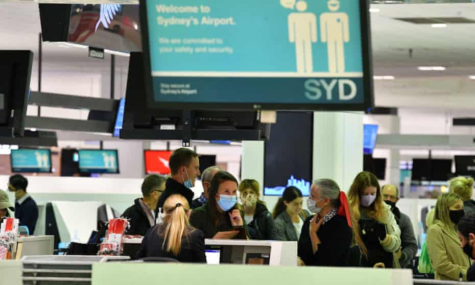 Passengers check in at Sydney International Airport