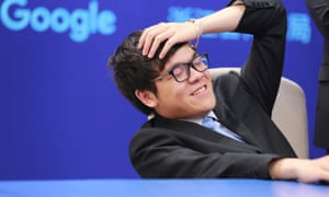Chinese Go player Ke Jie reacts during his second match against Google's artificial intelligence program AlphaGo.