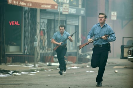 Will Poulter, right, as racist cop Krauss in Detroit.