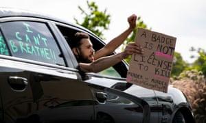 A protester in La Mesa, California, on Sunday.