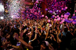 Balloons and confetti shower partygoers at the Eastwood Mall, in Quezon City, Philippines