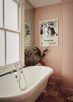 The en-suite bathroom with floor-to-ceiling mirror tiles and a vintage Sonic Youth poster.
