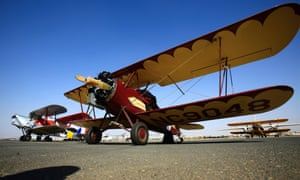A Travel Air 2000 biplane sitting on a runway at Khartoum airport during the Vintage Air Rally.