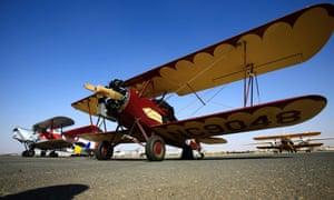 A Travel Air 2000 biplane sitting on a runway at Khartoum airport during the Vintage Air Rally.