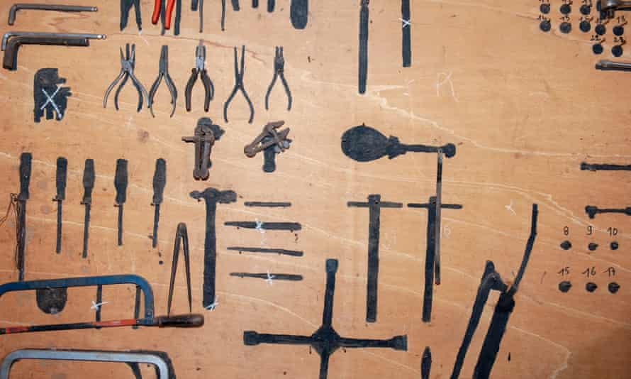 A wooden panel for storing the tools