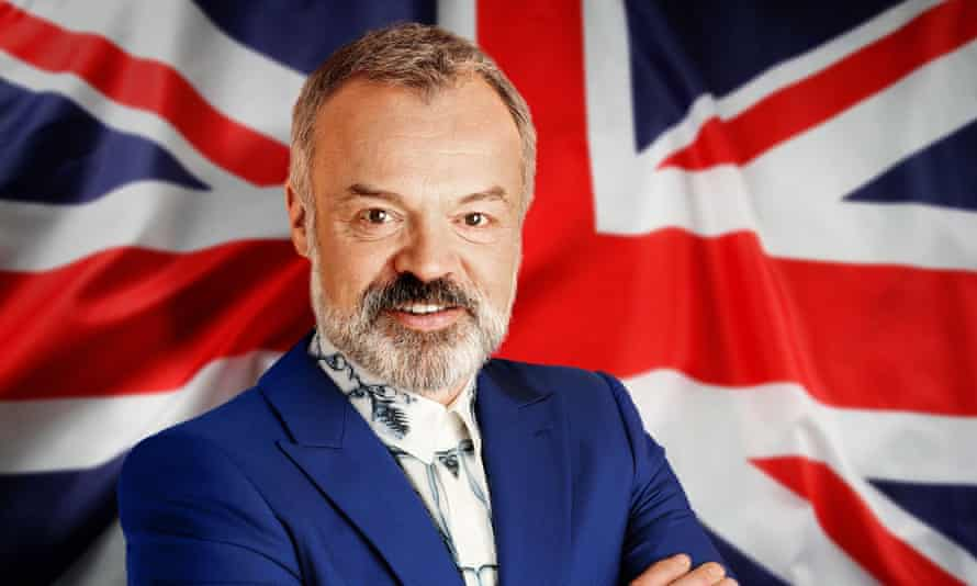 Graham Norton poses in front of the Union flag