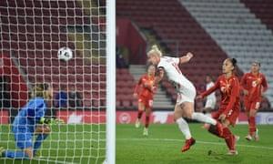 Beth England heads home England's fifth goal past Suarta Rechi of North Macedonia.