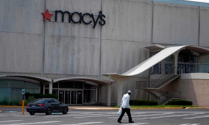A man walks through an empty parking of a Macy's store in Camp Springs, Maryland. The true scale of Covid-19's impact on the US economy is yet to be determined.