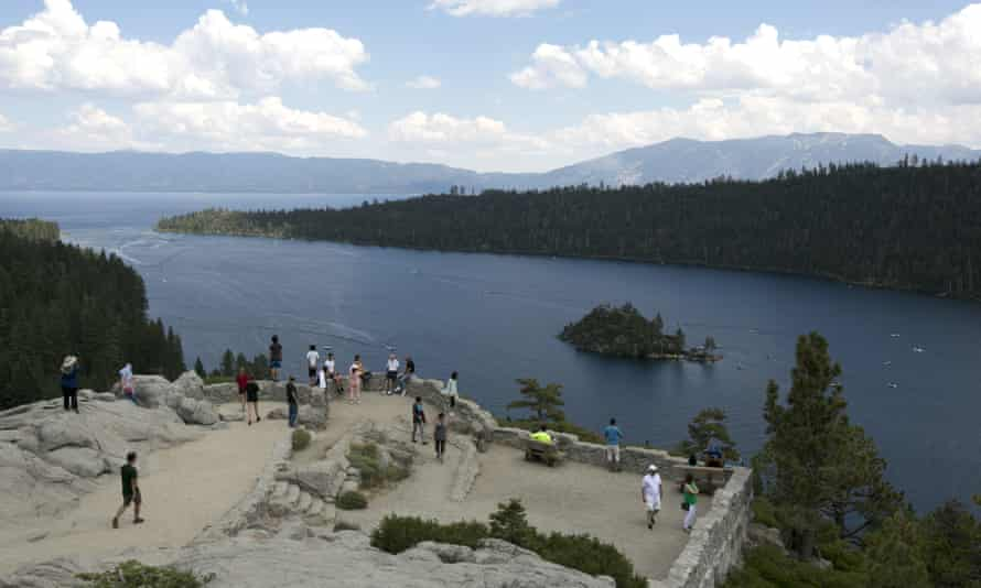 Visitors view Emerald Bay on the west shore of Lake Tahoe, near South Lake Tahoe, California, 8 August 2017.