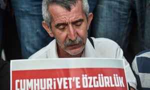A protester holds a placard reading Freedom to Cumhuriyet