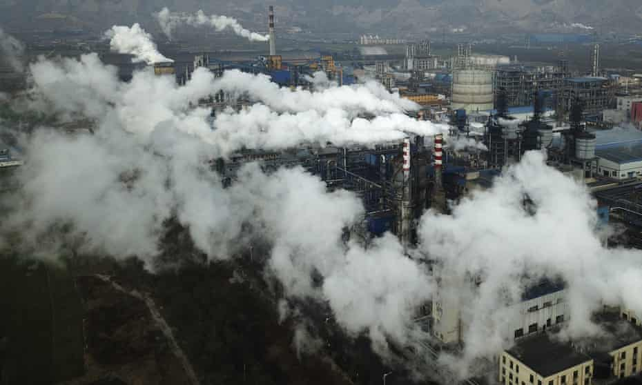 Smoke and steam rise from a coal processing plant in central China's Shanxi province.
