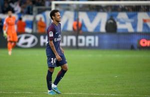 Neymar walks off after receiving a red card.