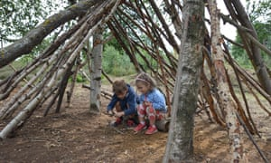 The writer's children have a go at den building, RSPB The Lodge, Sandy, Bedfordshire, UK
