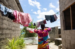 Miriam Abdalah hanging out washing