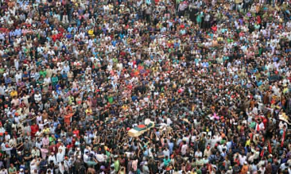 Mourners gather for the funeral of Ahmed Rajib Haider in Dhaka.