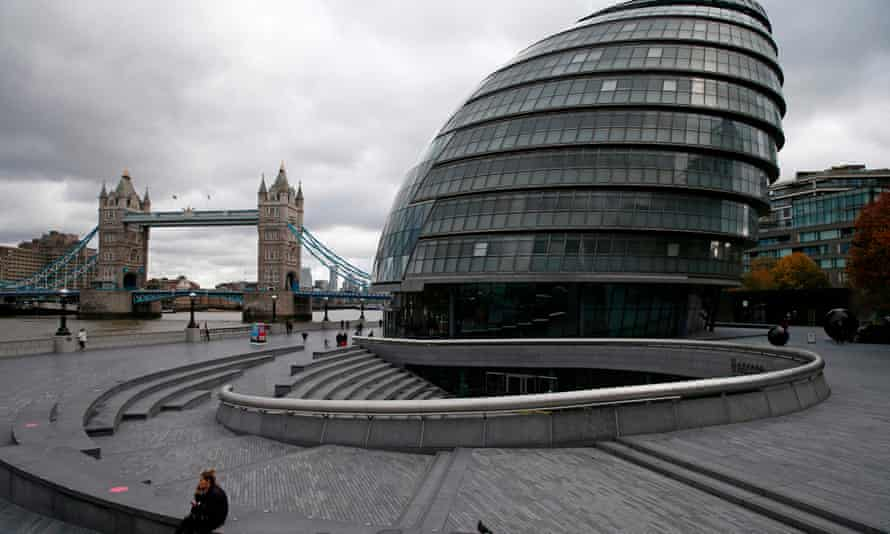 City Hall on the southern bank of the River Thames with Tower Bridge in the background.