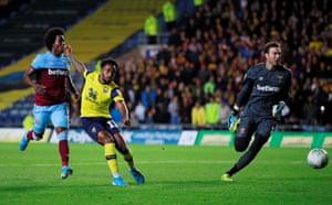 Oxford United's Tariqe Fosu scores their third goal.