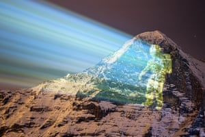 The Eiger, Switzerland. A giant projection of an astronaut on the north face of the Eiger mountain, by the Swiss light artist Gerry Hofstetter. The artistic projection pays tribute to Nasa's Perseverance rover Mars mission