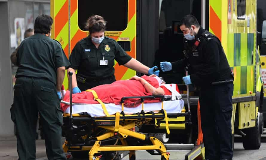 A patient loaded on to a stretcher by an ambulance.