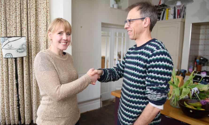 Linda Geddes and Nic Fleming shake hands.