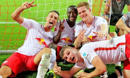 RB Leipzig players celebrate beating Borussia Dortmund in their first ever home Bundesliga match.