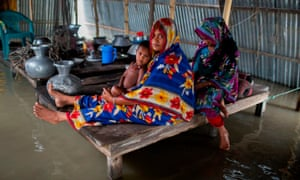 A flood-affected family in Kurigram, Bangladesh on 26 July 2019. 'Poorer countries, which broadly speaking are the least to blame for the climate crisis, will suffer most.'