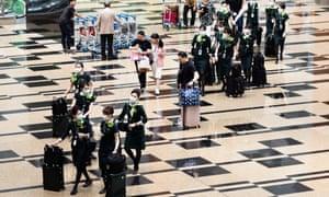 Visitors wear masks at Changi airport, Singapore, on Friday.