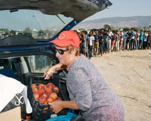 Reinhilde Michalakopoulos, German owner of the Kos Palace hotel, delivers peaches and bread from her kitchens to refugees