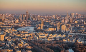Sunset over Whitehall, aerial view, with Southbank and City of London