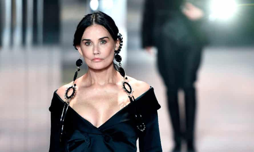 Demi Moore opened the show in off-the-shoulder black satin.