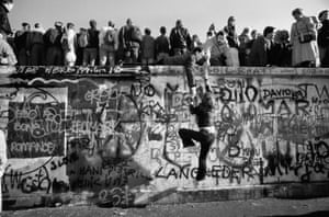 Crowds gathering on top of the Berlin Wall on the morning of November 10th, 1989, when East Berliners were allowed to cross into the west for the first time. Hours later the first section of the Berlin Wall was torn down and thousands of people flooded out of East Germany
