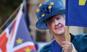 An anti-Brexit protester wearing a mask of the Queen last month.