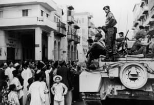 Egyptians crowd around a British tank in Port Said during the Suez crisis, 12 November 1956.