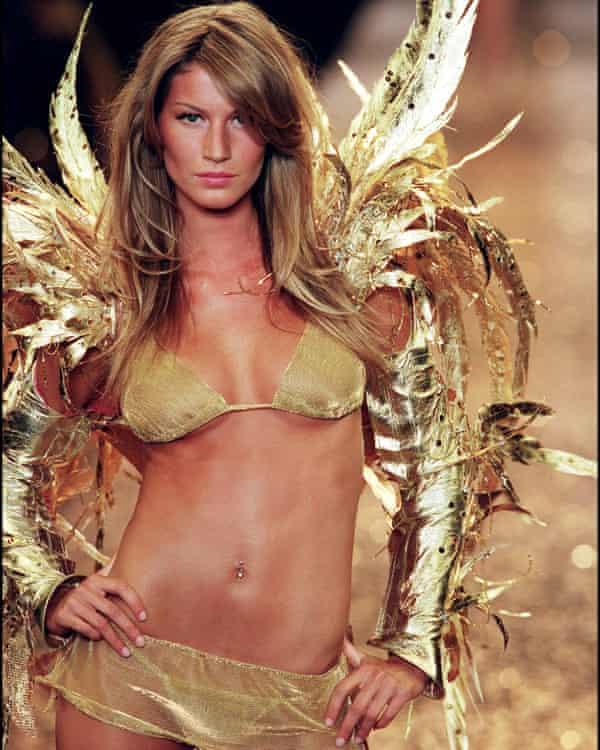 Golden girl: Gisele modelling Victoria's Secret in 2000.