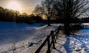 The dawn sun rises over a snow covered Nettleton Bottom