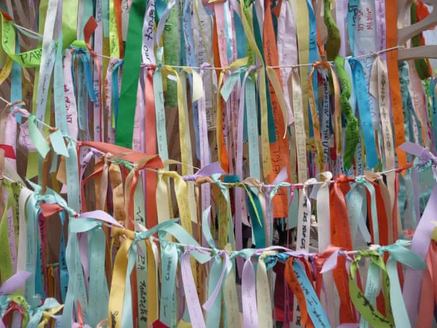Climate ribbons inscribed with messages about what people hope not to lose as a result of climate change