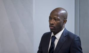 Former Ivory Coast militia leader Charles Blé Goudé arrives in court in The Hague.