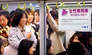 Female passengers wait to leave Tokyo's Shinjuku station.