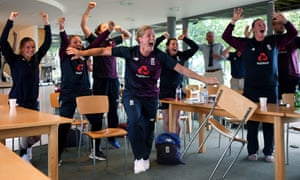 Katherine Brunt (c) and Anya Shrubsole (r) of England Women celebrate England men winning the Final of the ICC Cricket World Cup against New Zealand during Day Three of the International Friendly match between England Women and Australia A Women at Millfield School on July 14, 2019 in Glastonbury, England. (Photo by Alex Davidson/Getty Images)