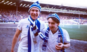 Doug Rougvie and Pat Nevin celebrate Chelsea's 1986 Full Members' Cup triumph, a day after the Blues had won a league game at Southampton.