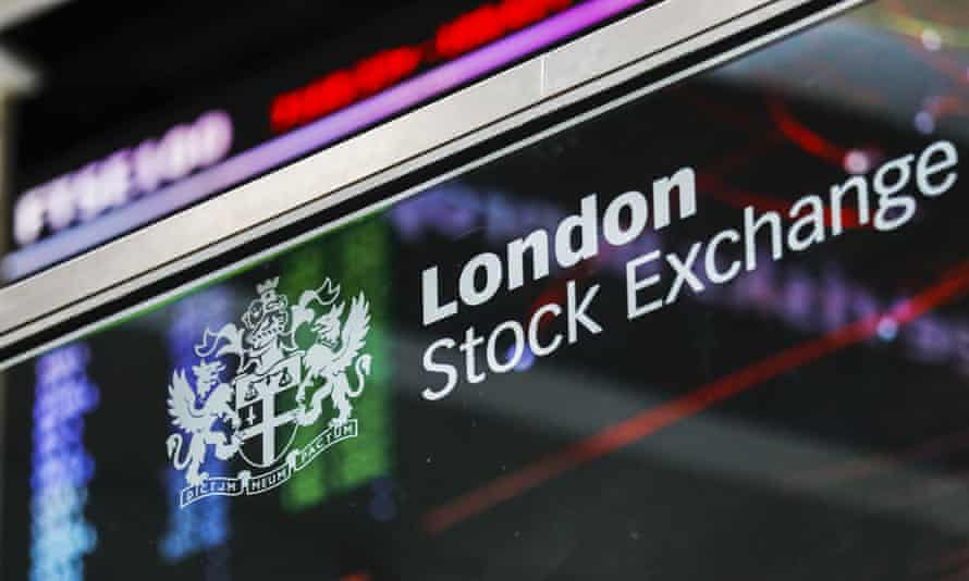 The London Stock Exchange logo sits in front of FTSE 100 Index share price information