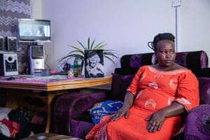 Asiah, 37, who experienced years of domestic violence and now runs a hair salon and a shop