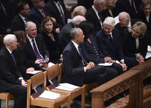 The Obamas, Clintons, and Carters sit before the funeral service.