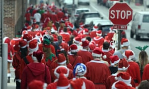 People dressed as Santa and other holiday related outfits parade around the Brooklyn section of the city during the SantaCon 2015 in New York City December 12, 2015, the 21st anniversary of the event that sees hundreds of people dress as Father Christmas. AFP PHOTO / TIMOTHY A. CLARYTIMOTHY A. CLARY/AFP/Getty Images