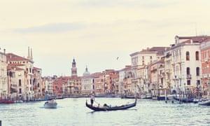 Gondolier on lagoon in Venice