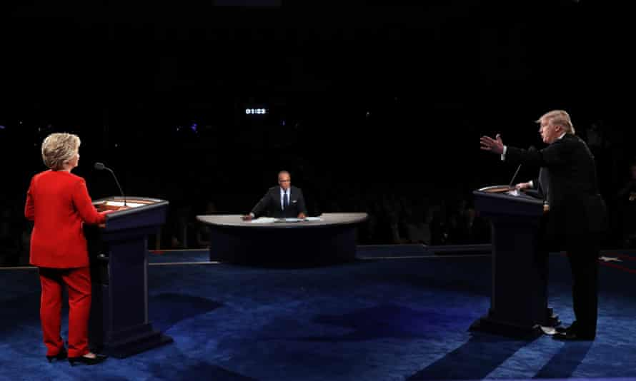 Republican presidential nominee Donald Trump speaks as Democratic presidential nominee Hillary Clinton, listens during the debate on Monday.