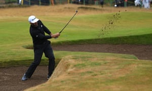 Dustin Johnson plays from an 8th hole bunker during his second-round 72 at the Open Championship, which followed a 76 on Thursday.