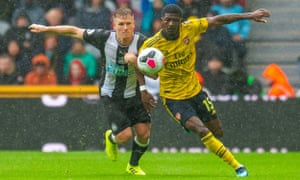Matt Ritchie battles Ainsley Maitland-Niles for the ball during Newcastle's game against Arsenal.